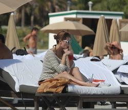 http://img224.imagevenue.com/loc1099/th_312757662_Mischa_Barton_Bikini_Candids_on_the_Beach_in_Miami_December_27_2011_243_122_1099lo.jpg