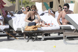 http://img224.imagevenue.com/loc824/th_312338992_Mischa_Barton_Bikini_Candids_on_the_Beach_in_Miami_December_27_2011_172_122_824lo.jpg